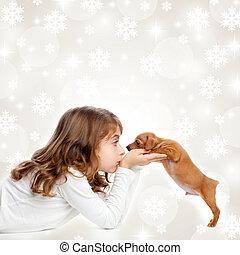 christmas children girl hug a puppy brown dog - christmas...