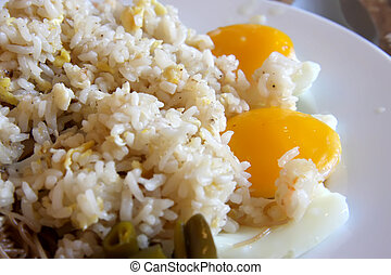 Fried rice and eggs - Fried rice with fried eggs whole yolk