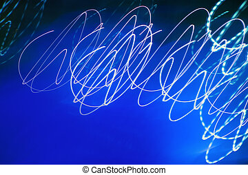 Abstract motion blurred lights on blue