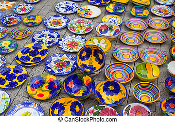 ceramics from Mediterranean Spain in street market display...