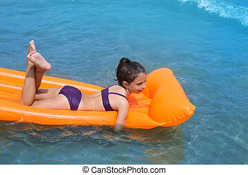 children kid girl playing in beach floating lounge