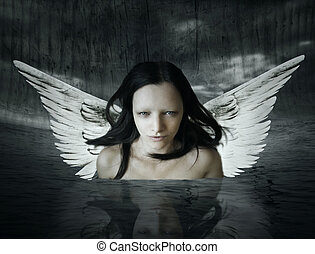 Angelic being that comes out of the water in a setting dark...