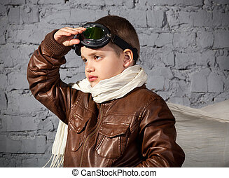 Little boy dreaming of becoming a pilot in retro style...