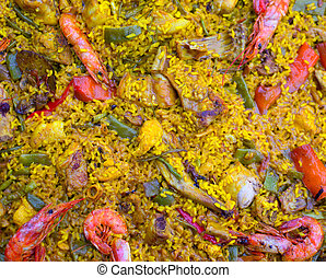 Spanish rice paella mixed of meat and seafood in Valencian...