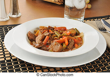 Pot roast dinner - A bowl of pot roast with carrots and...