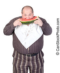 Obese man eating watermelon