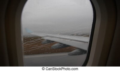 Rainy takeoff. - Commercial passenger jet taking off. Rain...