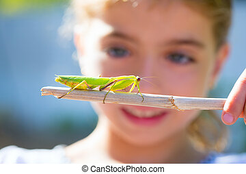 naturalist biologist kid girl looking praying mantis -...