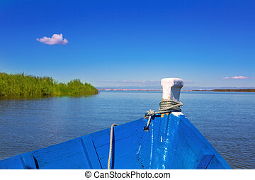 Blue boat sailing in Albufera lake of Valencia in a sunny...