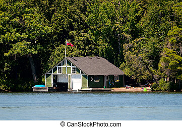 Old boathouse with Canadian flag