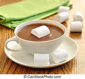 Hot chocolate with marshmallows on a brown table