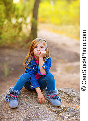 blond kid girl pensive bored in the forest outdoor - blond...