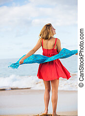 Beautiful Girl in Red Dress on The Beach. Travel and...