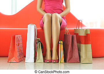 Woman shopping - Woman with bags in shopping mall