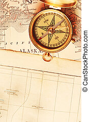 Antique brass compass over old map - Antique brass compass...