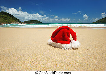 Tropical christmas - Santas hat on a tropical beach