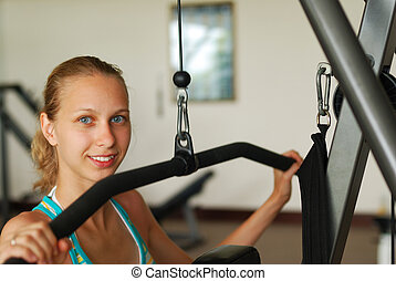 Workout - Girl in a fitness center