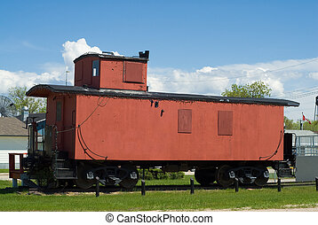 Train Caboose - A red train caboose sitting on some railroad...