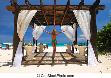 Girl in pergola - Beautiful caribbean beach with pergola in...