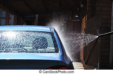 Car washing - Blue car washing on open air
