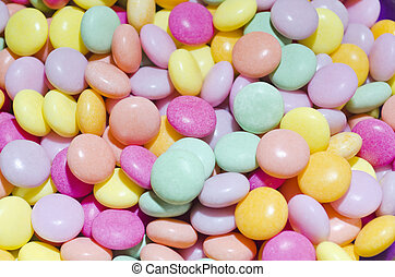 M&Ms-Like Candies - Pastel-colored round candies that look...