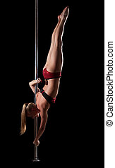 Strong blond woman posing on pole - Strong blond woman...