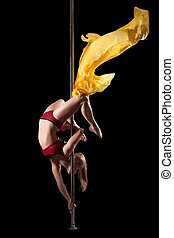 Woman show exercise in pole dance with fabric