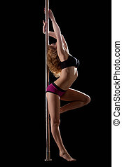 Sexy woman stand in pole dance - Sexy blond woman stand in...