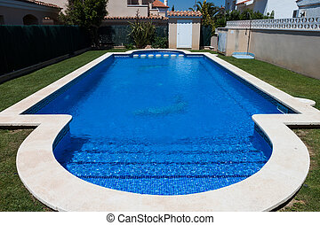 blue outdoor pool near villa - blue water surface in outdoor...