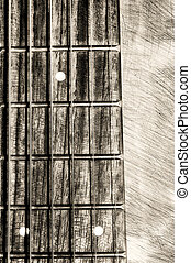 Guitar neck fingerboard on textured background, close up...
