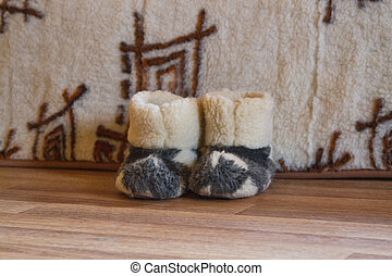 warm slippers on the floor beside the bed