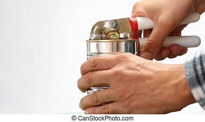 metal can opener and tin can - man with metal can opener...
