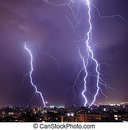 Lightning in the city - Photo of beautiful powerful...