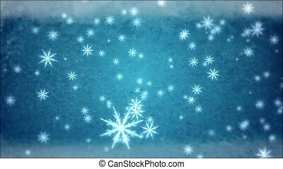 Snowflakes - Large snowflakes are falling against a blue...