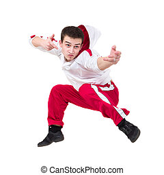 Young man dancer jumping against isolated white background