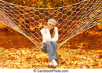 Woman swinging in hammock - Picture of attractive woman...
