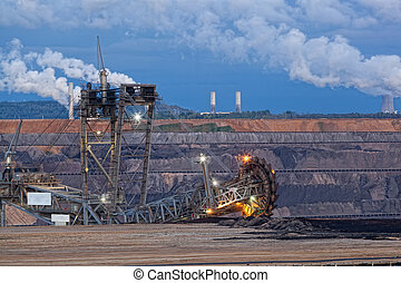 Bucket-wheel excavator in an open pit. landscape with...