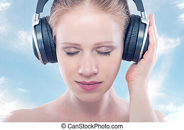 music concept. woman with headphones relax, enjoy the music...