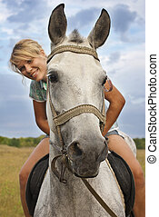 Girl and gray horse - Young adult women ridind on gray horse...