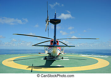 Helicopter on Helideck - A helicopter on helideck in the...