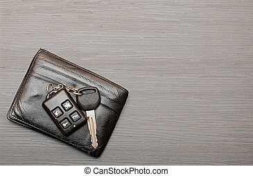 car keys and documents on dark wooden background