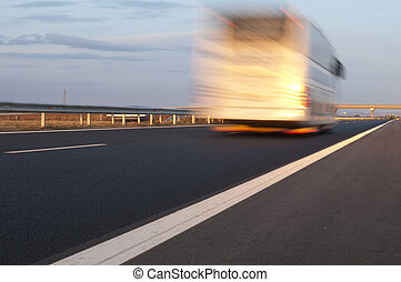 Bus traveling on highway. Motion blur effect