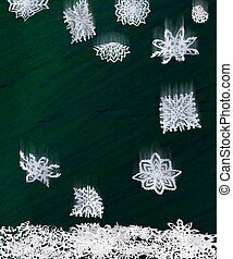 Origami falling snowflakes and pastel color background.