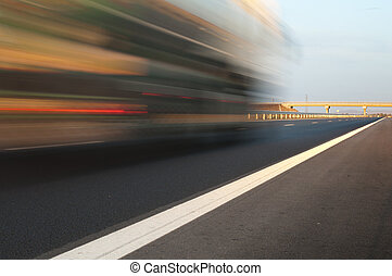 Bus traveling on highway Motion blur effect