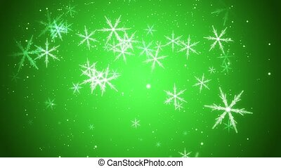 Snowflakes - Large snowflakes are falling against a green...