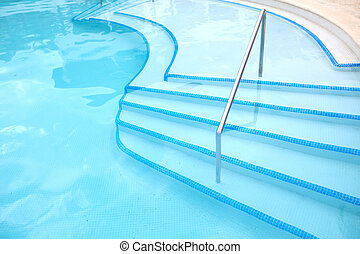 Swimming pool ladder. Luxury hotel resort.