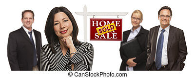 Mixed Race People with Sold Real Estate Sign Isolated -...