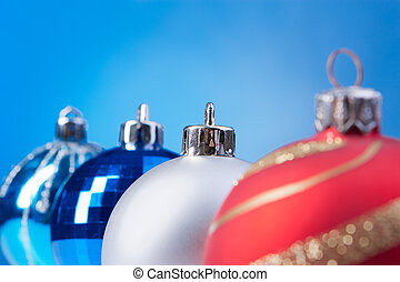 four christmas balls on the blue background