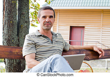 Man relaxing on a garden bench - Low angle view of a...