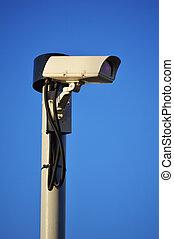 Security camera over a blue sky